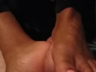 Ballbusting feet crushing balls between ebony toes