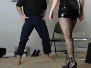 Blonde young domina ballbusting in latex outfit