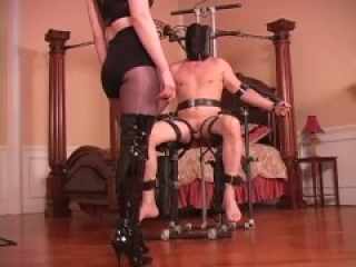 Blonde mistress in boots ballbusting in chair