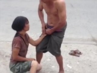 Ballbusting. Woman SQUEEZES husbands balls ON THE STREET