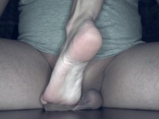 Foot play with cock and balls crush